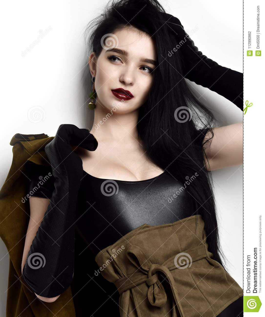 Beautiful woman wear fashion military cloth dark green jacket uniform on holiday day of victory May 9 Russia