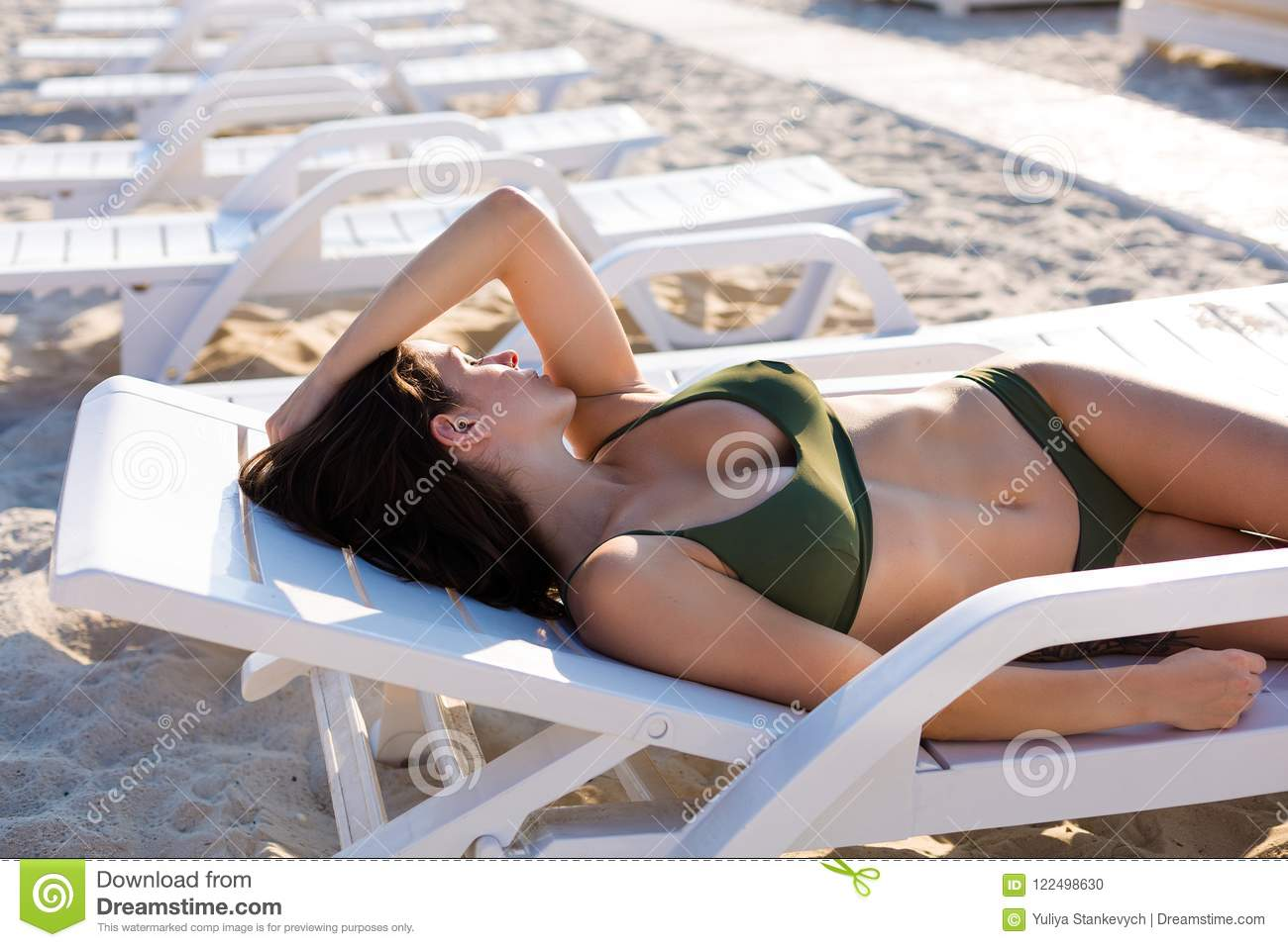 ea670a0a89 Woman tanning on the beach stock photo. Image of leisure - 122498630