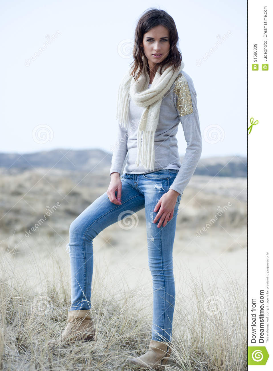 Beautiful Woman Wearing Grey Shirt And Jeans In The Dunes Stock Image - Image 31590309