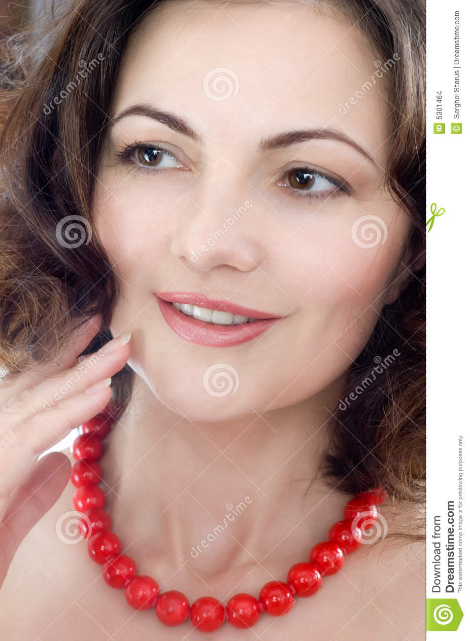 Beautiful woman wearing red corall beads