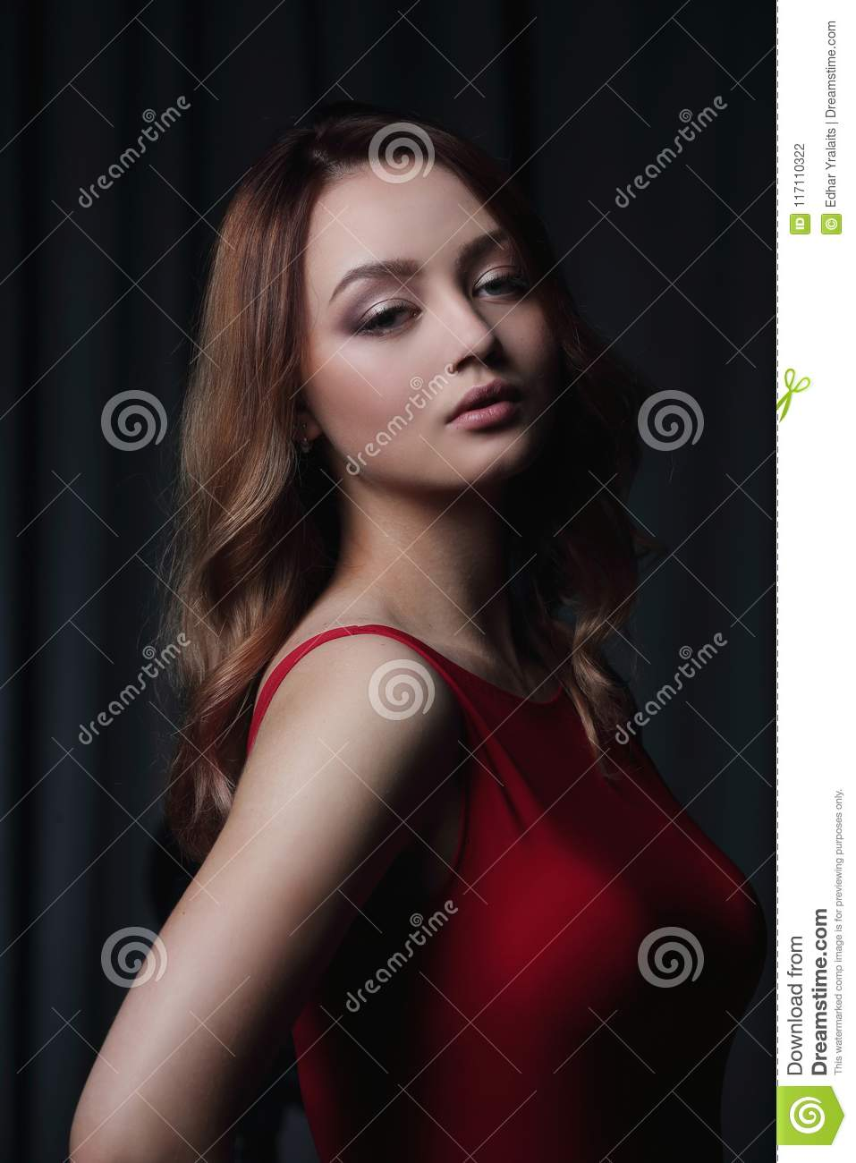 Face Of Young Beautiful Brunette Woman On Dark Background