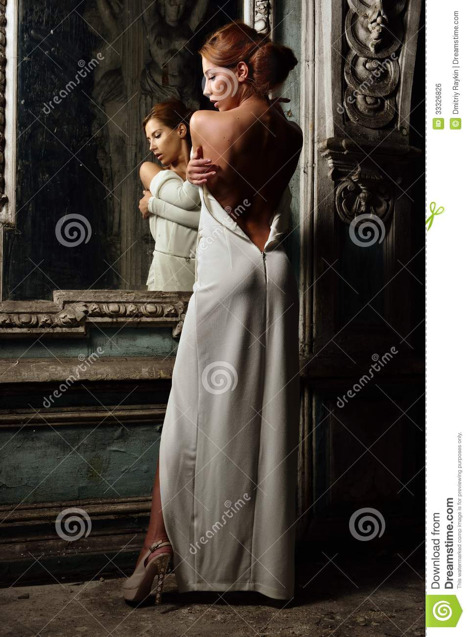 Beautiful Woman In White Dress With Naked Back. Stock