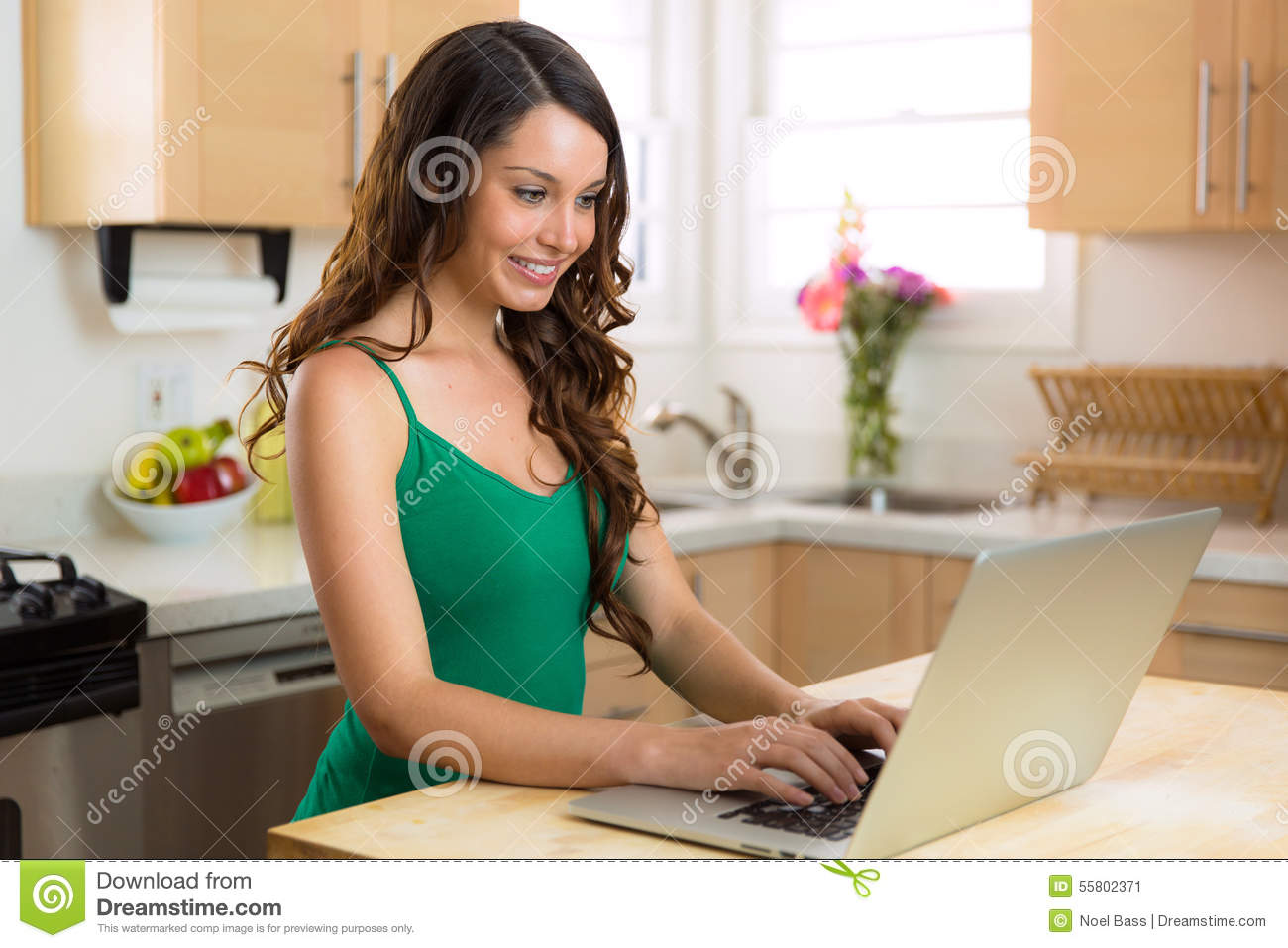 Beautiful woman working at home on laptop casual writer blogger