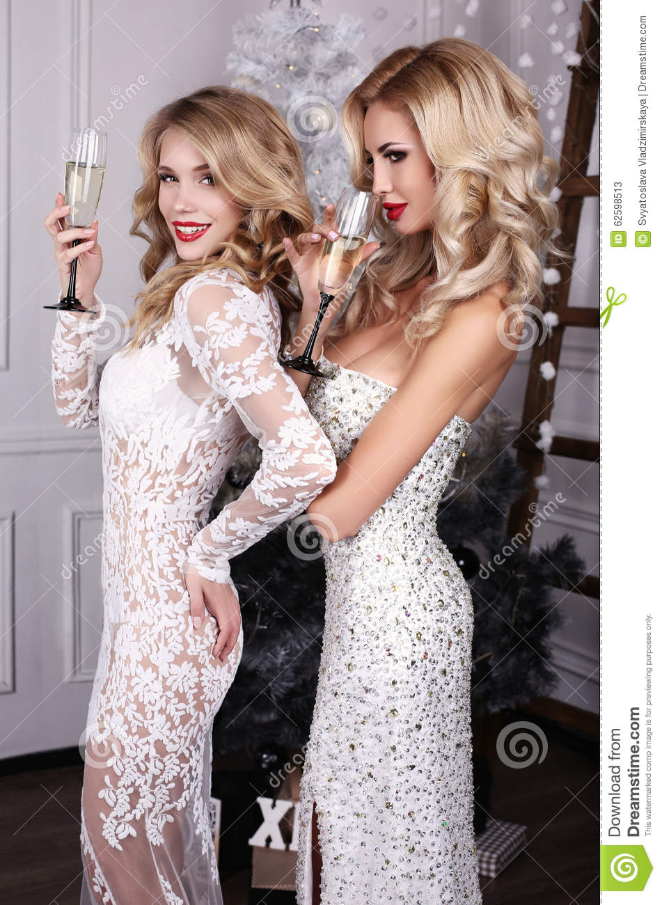 Beautiful Women With Champagne In Hands Celebrating New