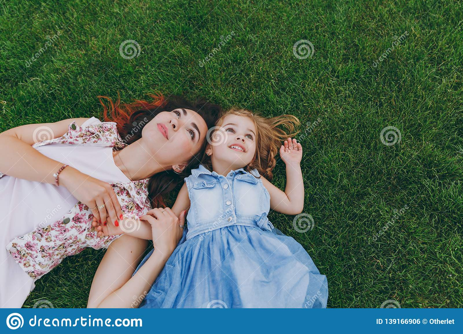3f7ad2c2dd9d Beautiful Woman In Light Dress And Little Cute Child Baby Girl Lie ...