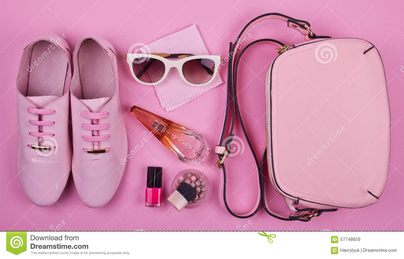 Beautiful women s minimal set of fashion accessories on a pink background 955fa3d47f70