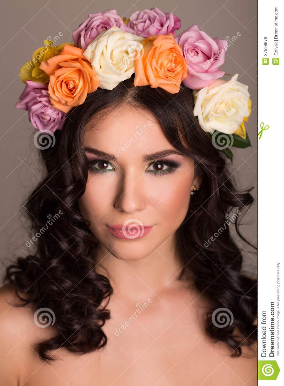 beautiful women supermodel in wreath of flowers close up