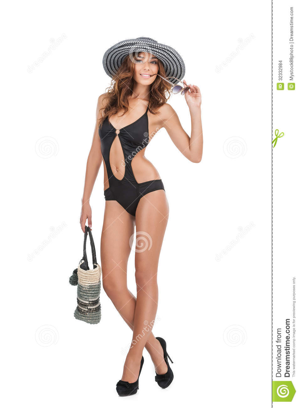 Beautiful women in swim wear. Full length of attractive young women in swim wear and hat looking at camera while isolated on white