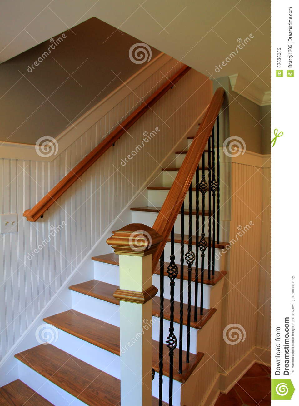 Beautiful wood staircase with cast iron rails leading - One time interior house cleaning ...