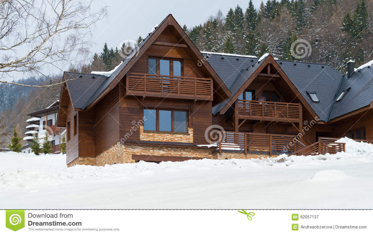 Beautiful wooden cottage covered in snow ski resort for Ski cottage