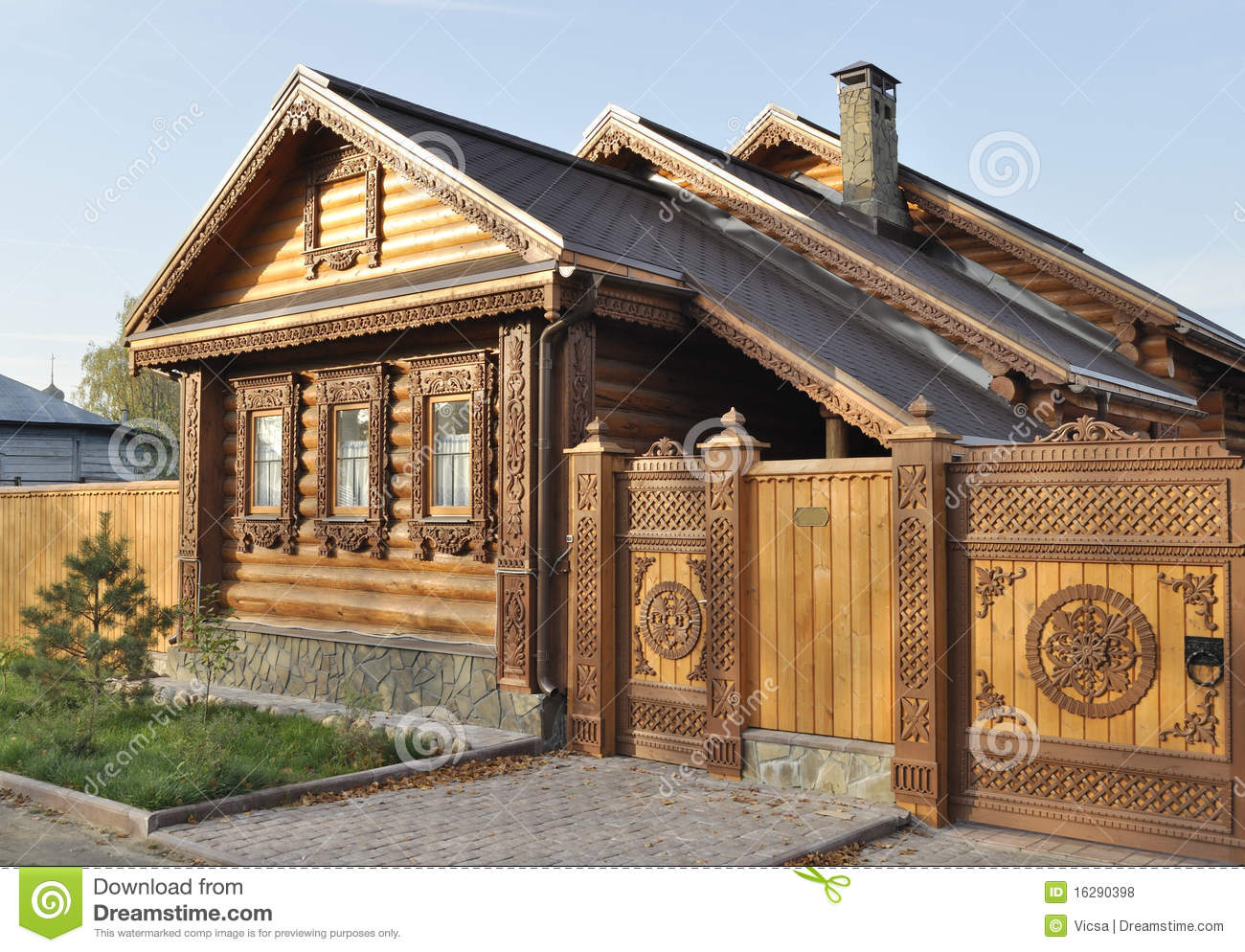 Beautiful wooden house with carved front stock photo for Beautiful front of houses