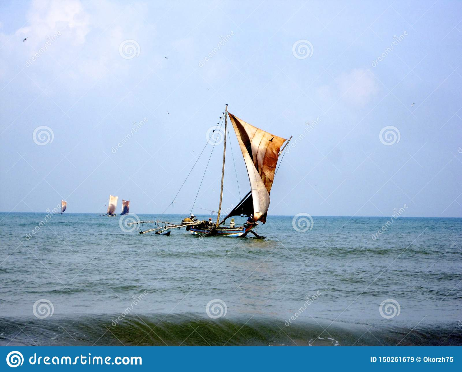 Beautiful wooden ship with leather sails on mast fluttering in wind