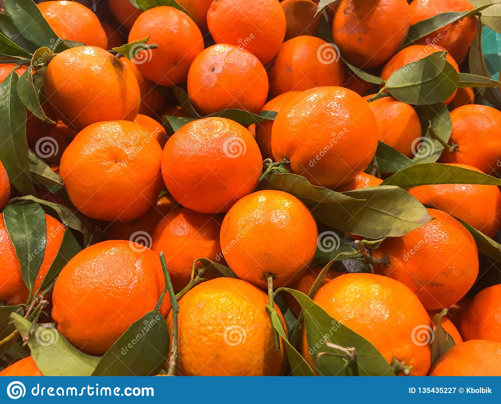 Beautiful yellow natural sweet tasty ripe soft round bright bright tangerines, fruits, clementines. Texture, background