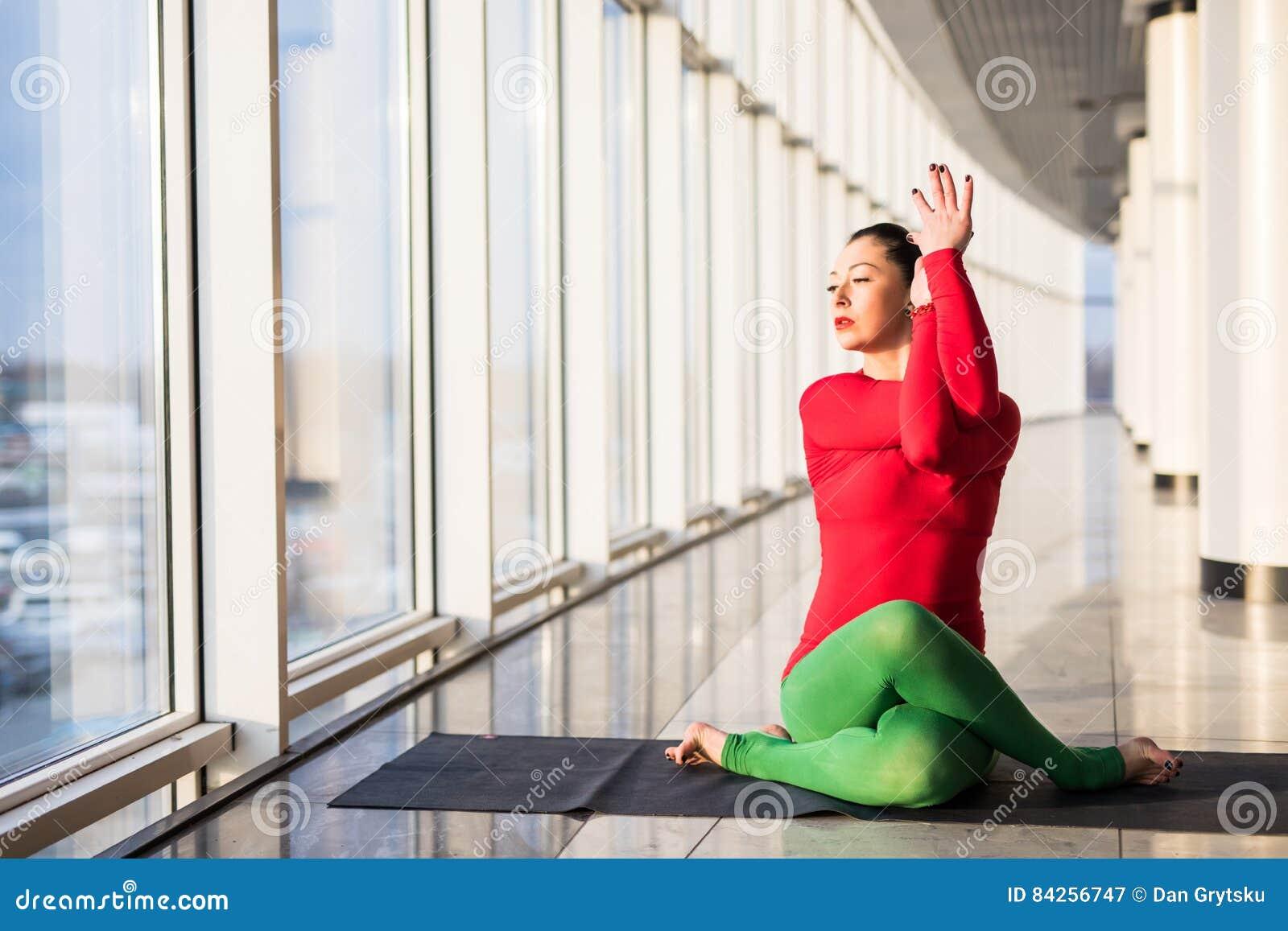 Beautiful yoga woman practice yoga poses on grey background.