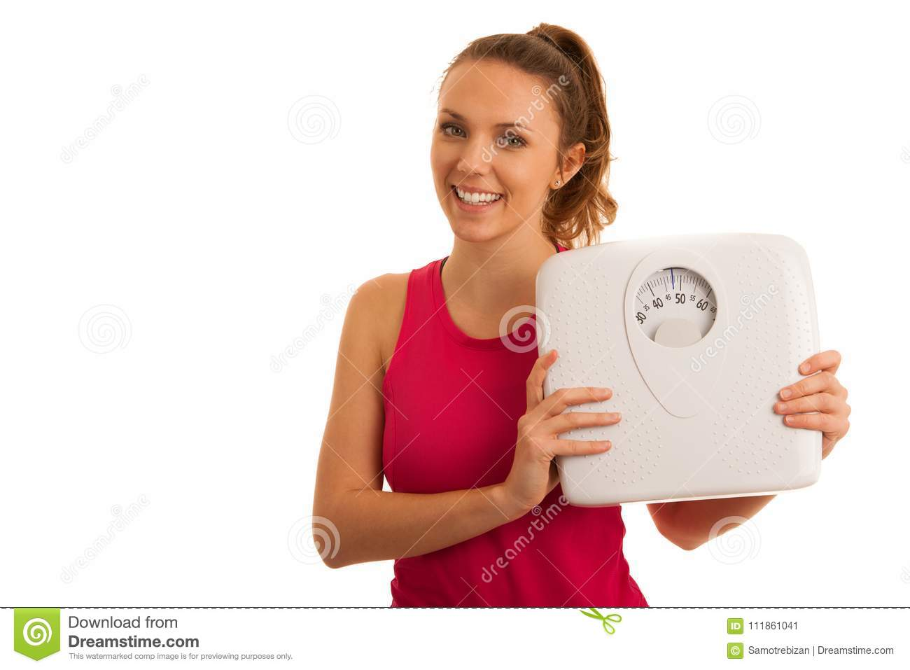 Beautiful young active fit woman hold scale as gesture of loosing weight isolated over white background - weight loss