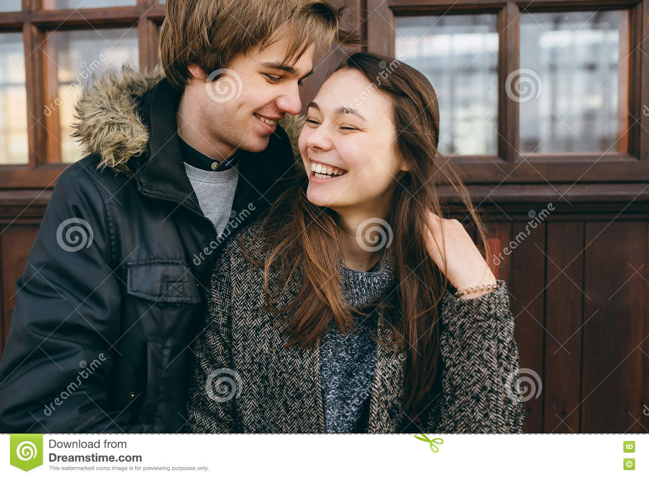 Beautiful young adult couple posing at camera
