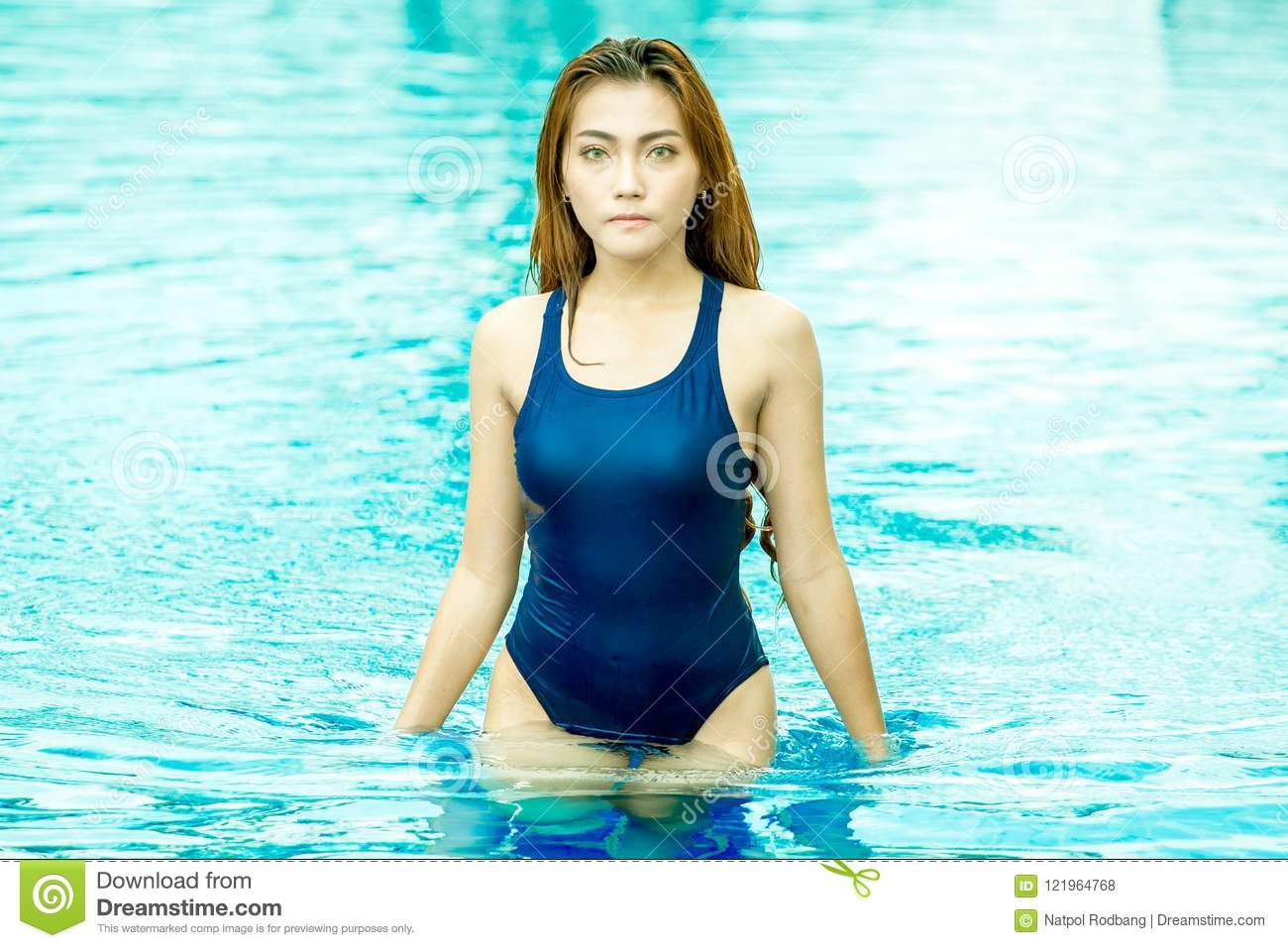 9705eba3040 Beautiful young asian sport woman getting out or walking in of swimming pool  . Happy lady girl swimmer in swimsuit standing relaxing in the pool