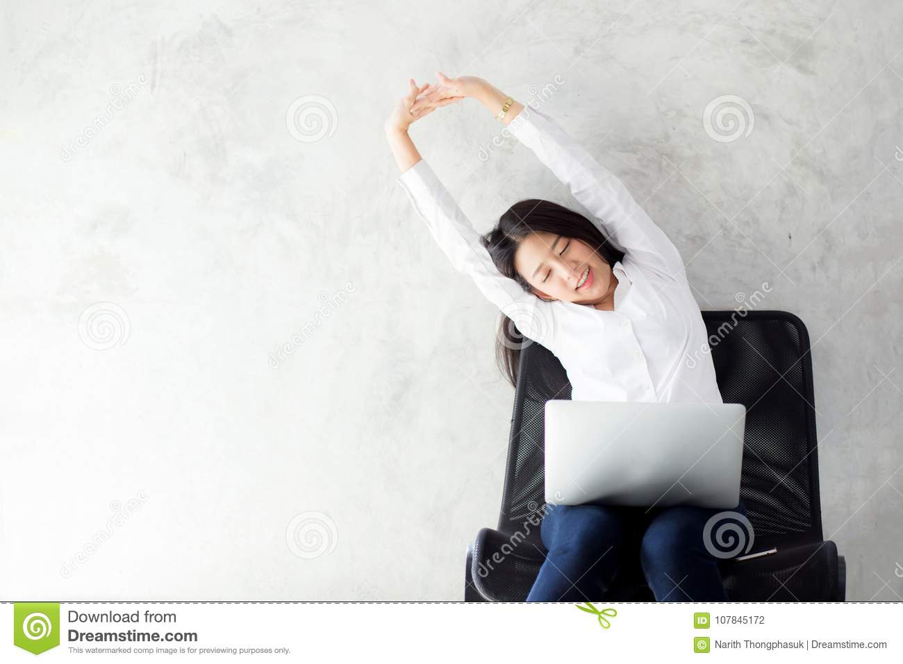 Beautiful young asian woman with laptop stretch and exercise relax after work success.