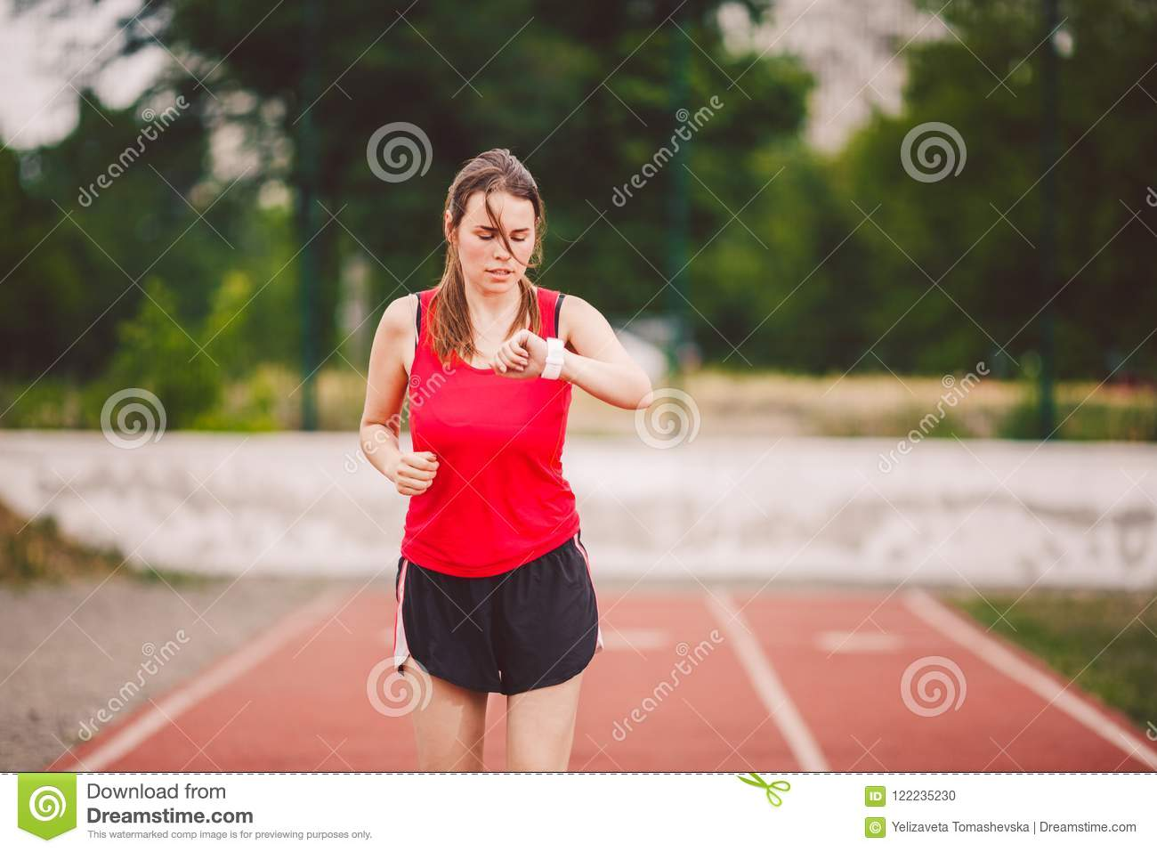 Beautiful Young Athlete Caucasian Woman With Big Breast In Red T