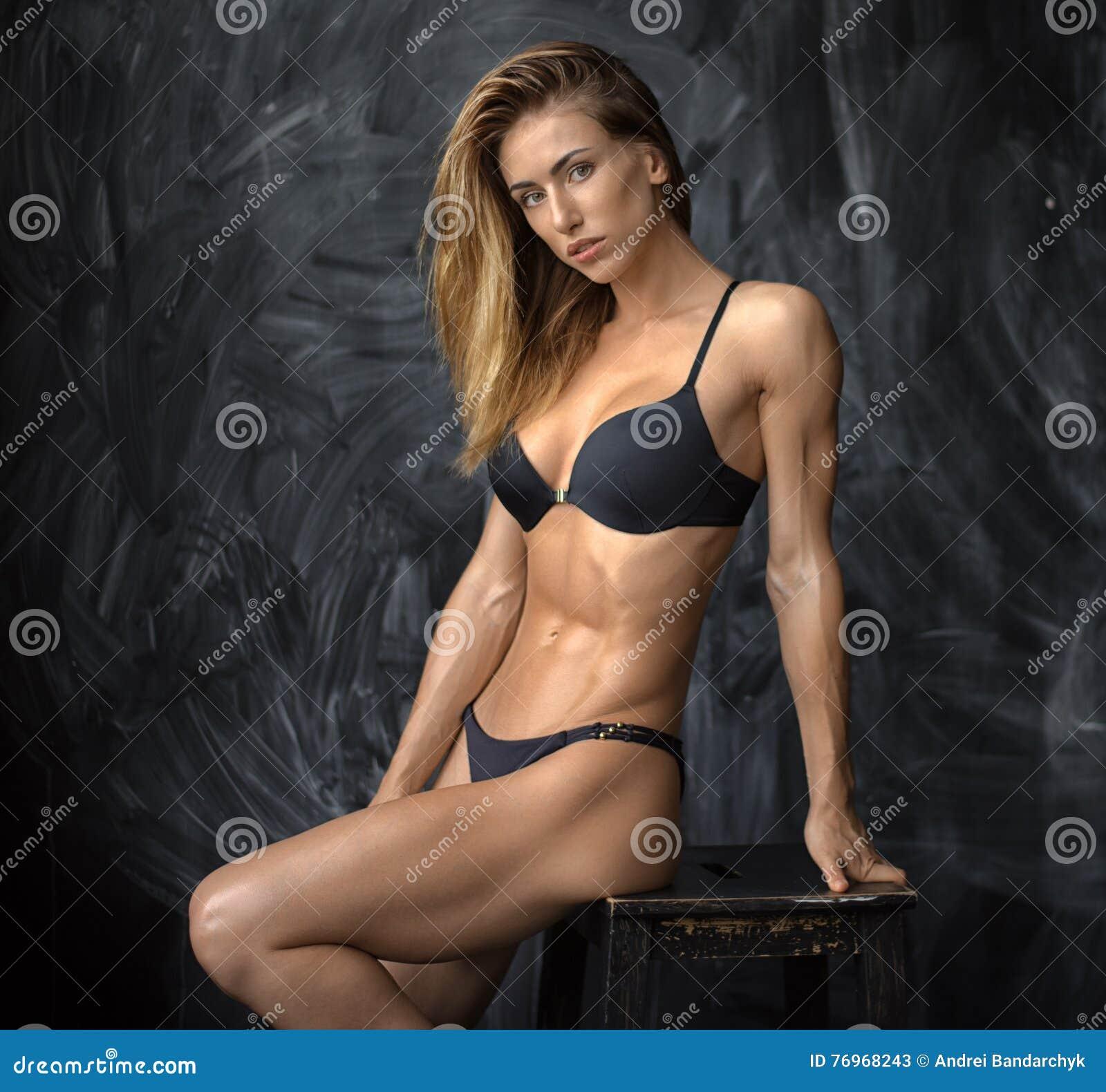 Beautiful young athletic girl in underwear on dark background stock jpg  1300x1301 Muscle girl underwear 5c2fddf2d
