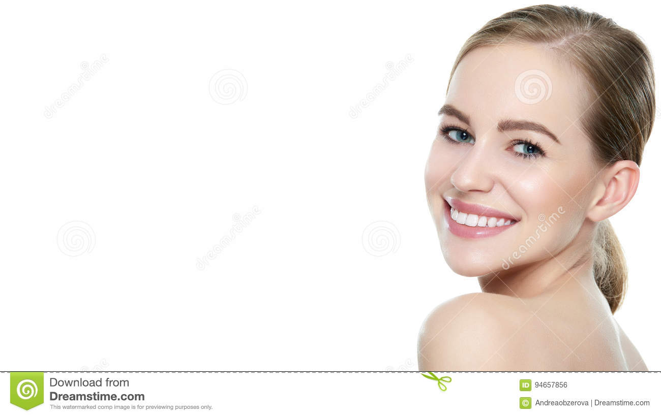 Beautiful young blond smiling woman with clean skin, natural make-up and perfect white teeth