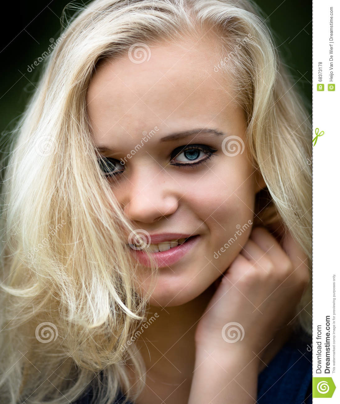 Beautiful Young Blond Teenage Girl Wearing Make Up