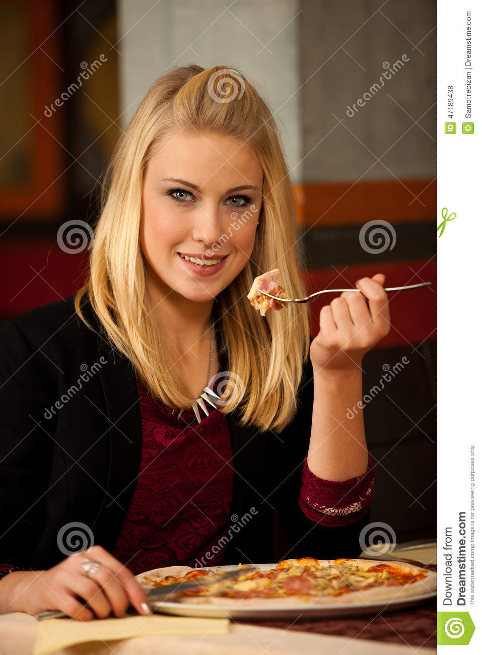Beautiful Eat In Kitchens: Beautiful Woman Eating A Pizza Royalty-Free Stock Photo