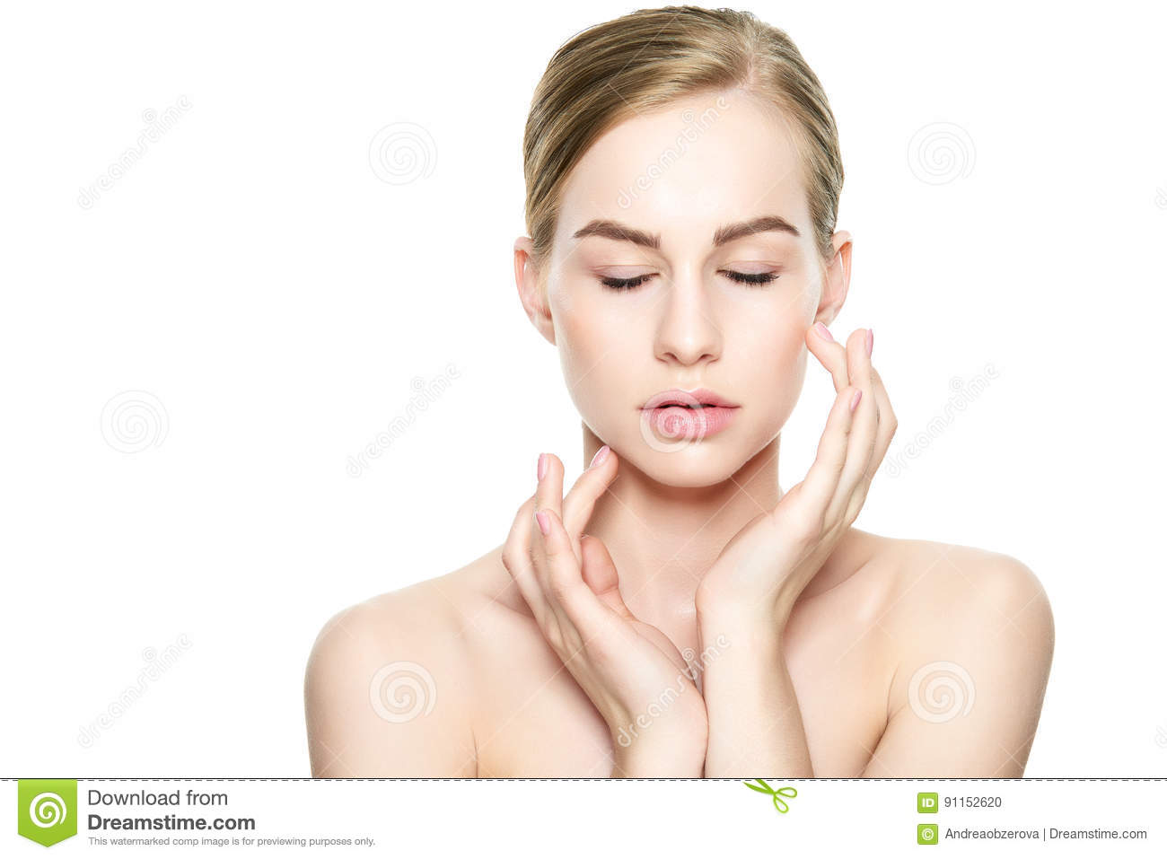Beautiful Young Blond Woman with Perfect Skin touching her face. Facial treatment. Cosmetology, beauty and spa concept.