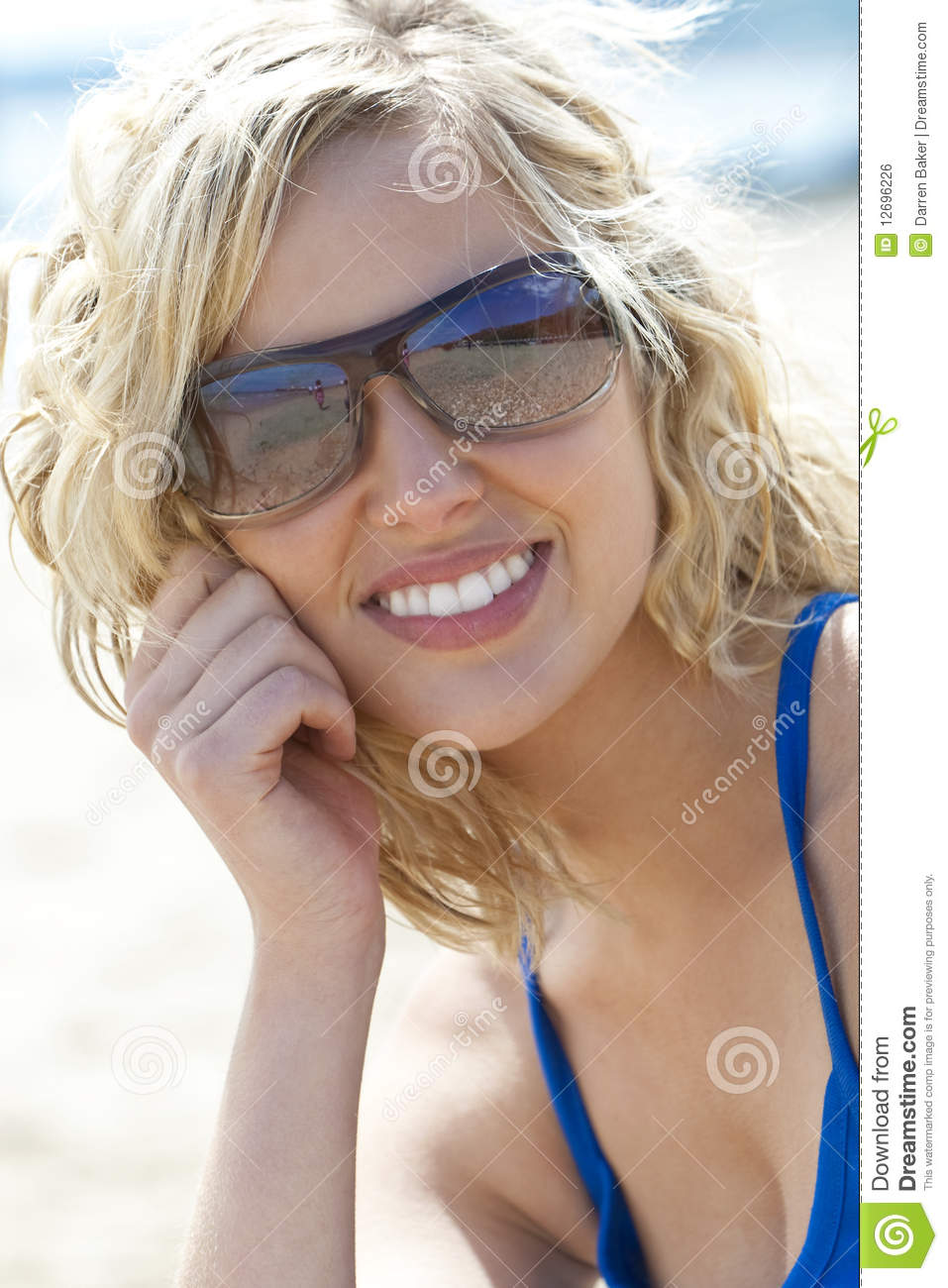 Beautiful Young Blond Woman in Sunglasses Smiling
