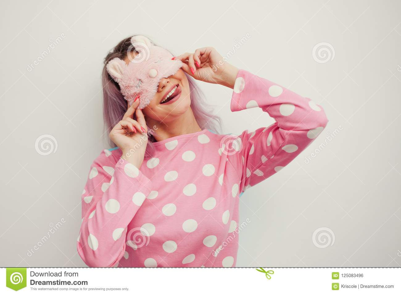 Beautiful Young Blonde In Pink Pajamas And A Sleep Mask On