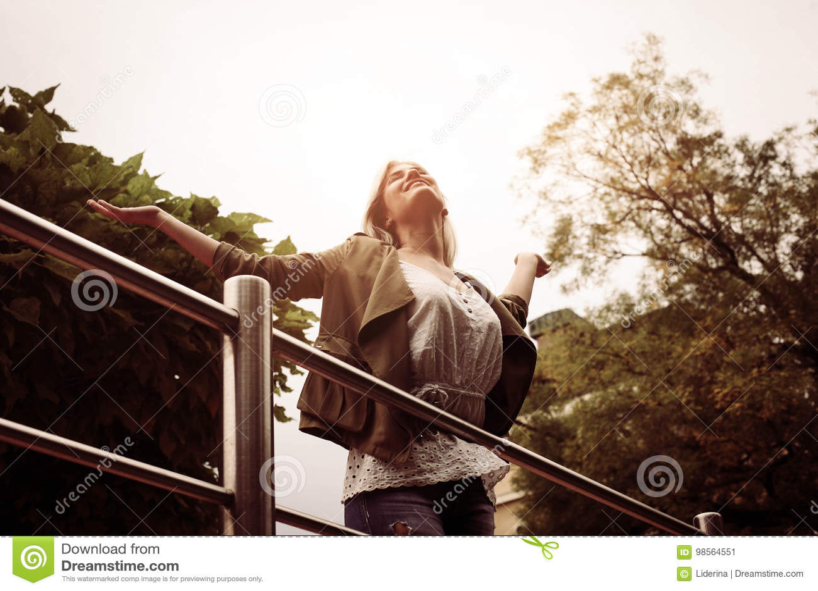 Beautiful young blonde woman outdoors.