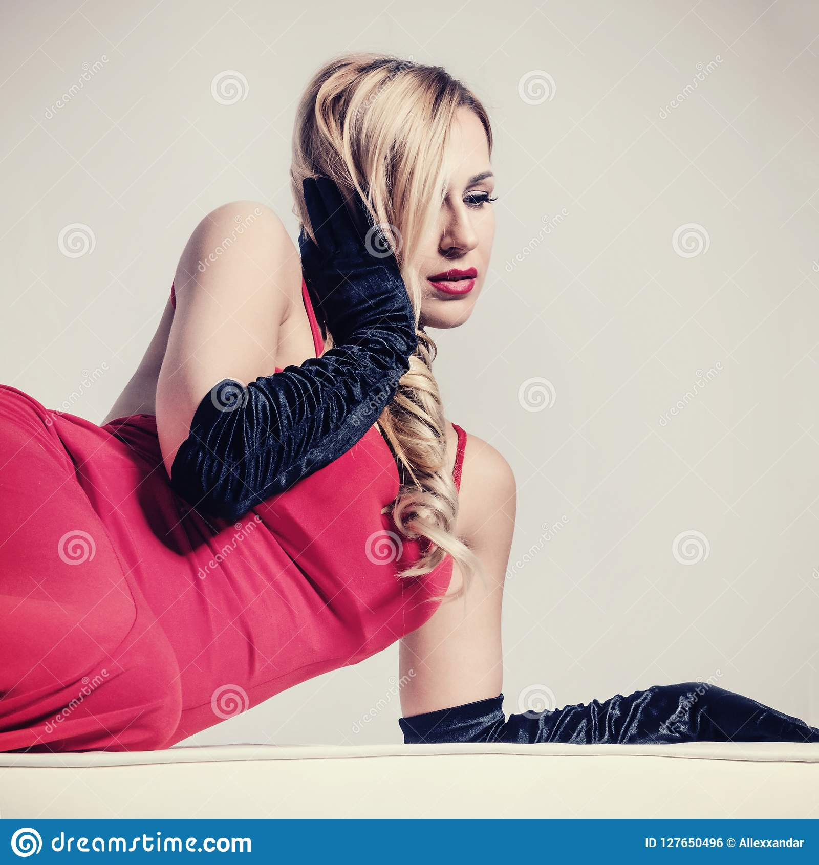 Beautiful young blonde woman in red evening dress retro look Retro style. ed6847e6cccc