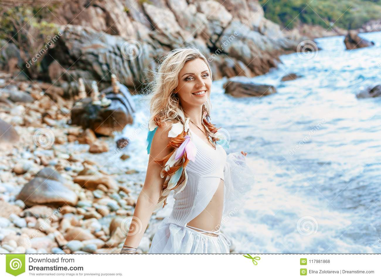 f4b3792bf1 Beautiful Young Boho Style Woman In White Dress On Stone Beach Stock ...
