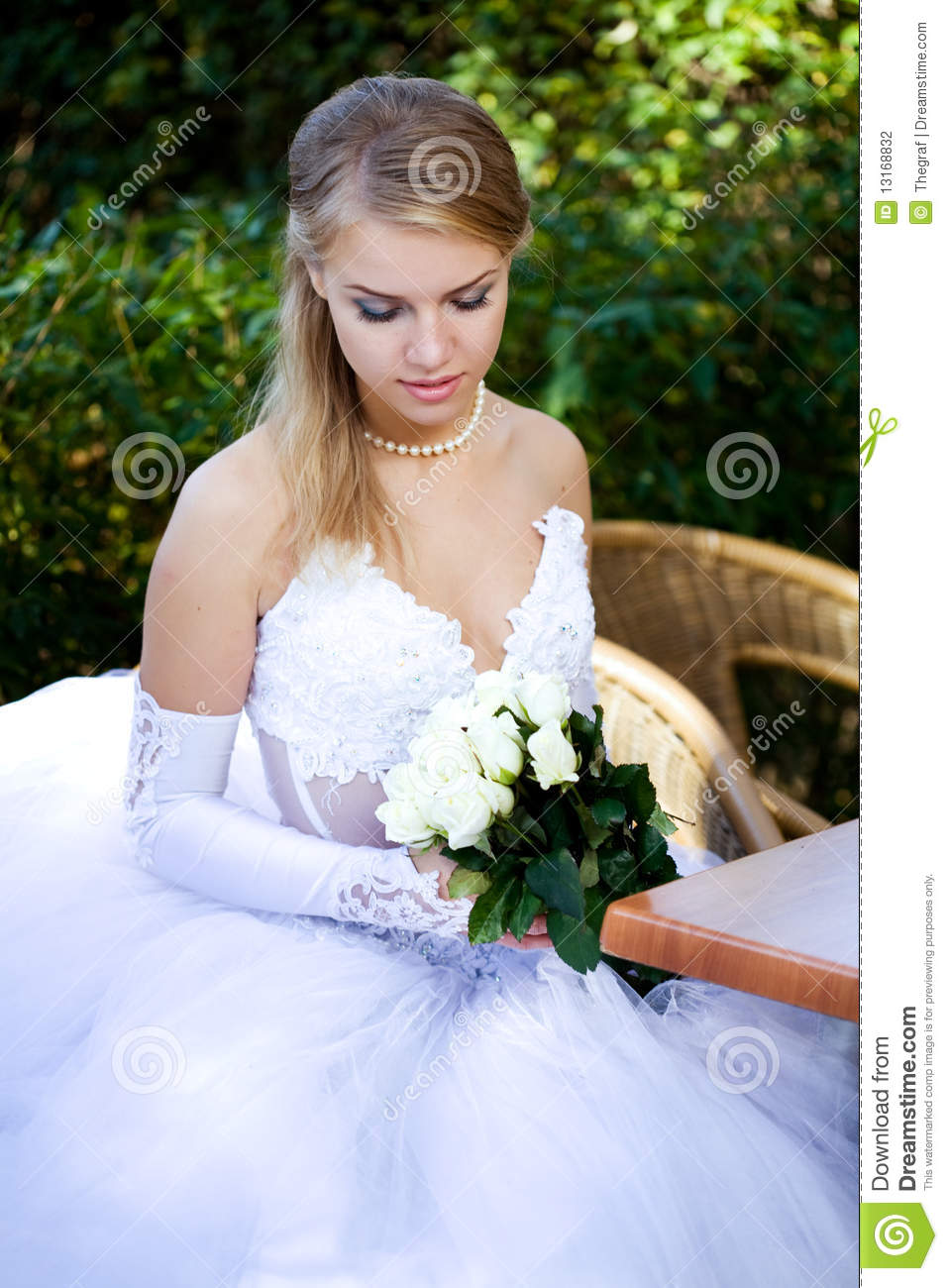 Young beautiful bride preparing reply