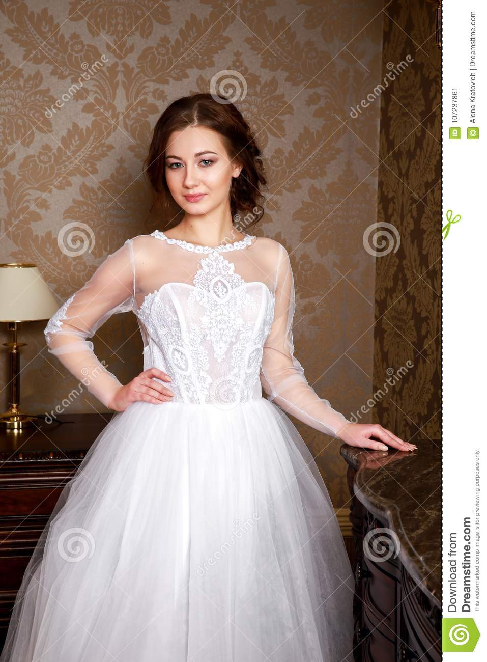Beautiful Young Bride With Brunette Hairs In A Bedroom. Classic ...