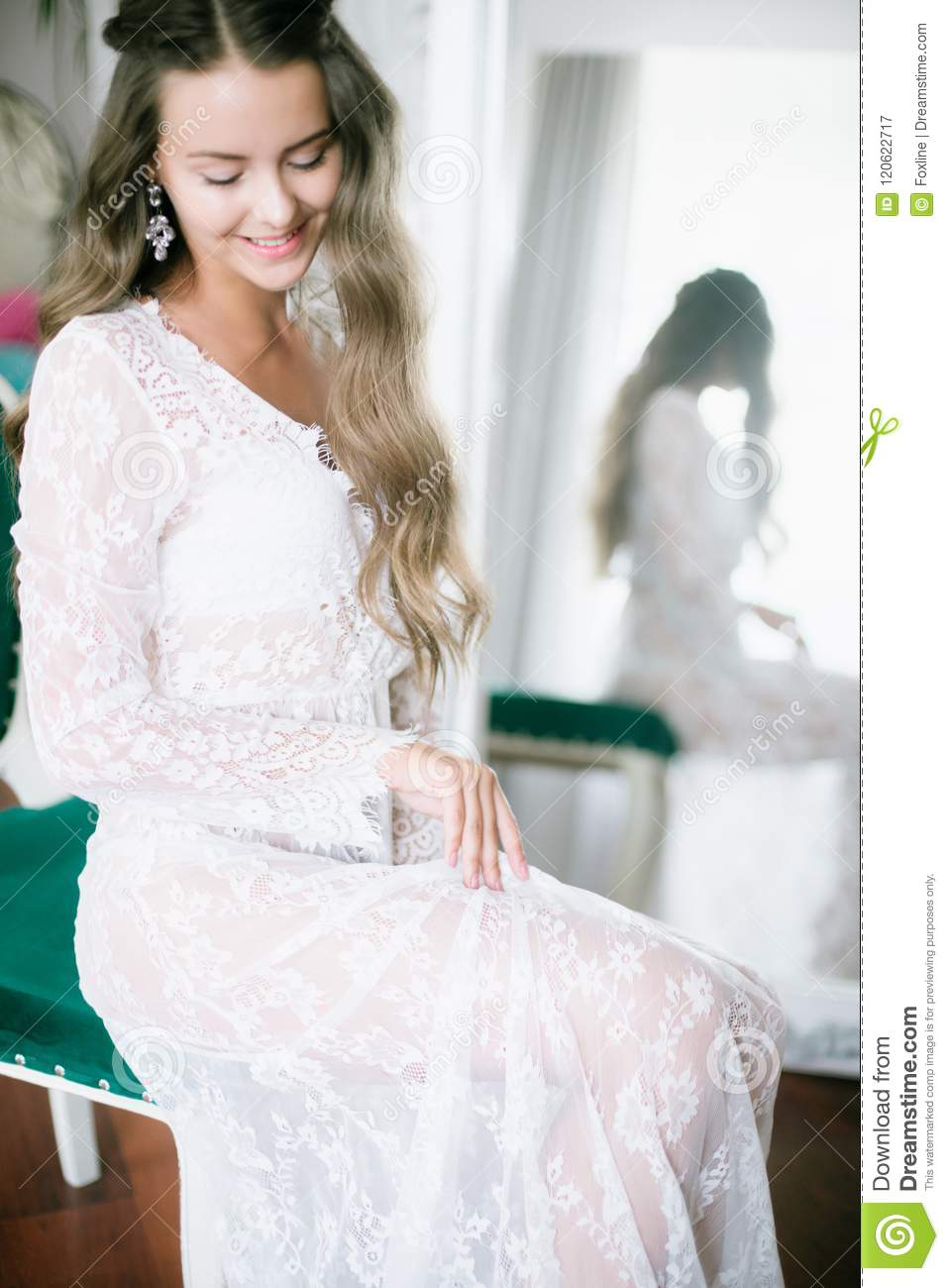 Beautiful Young Bride With Long Blond Curly Hair In A Long White