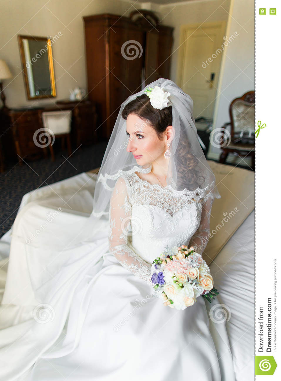 Beautiful Young Bride With Makeup, Fancy Hairstyle In White Dress ...