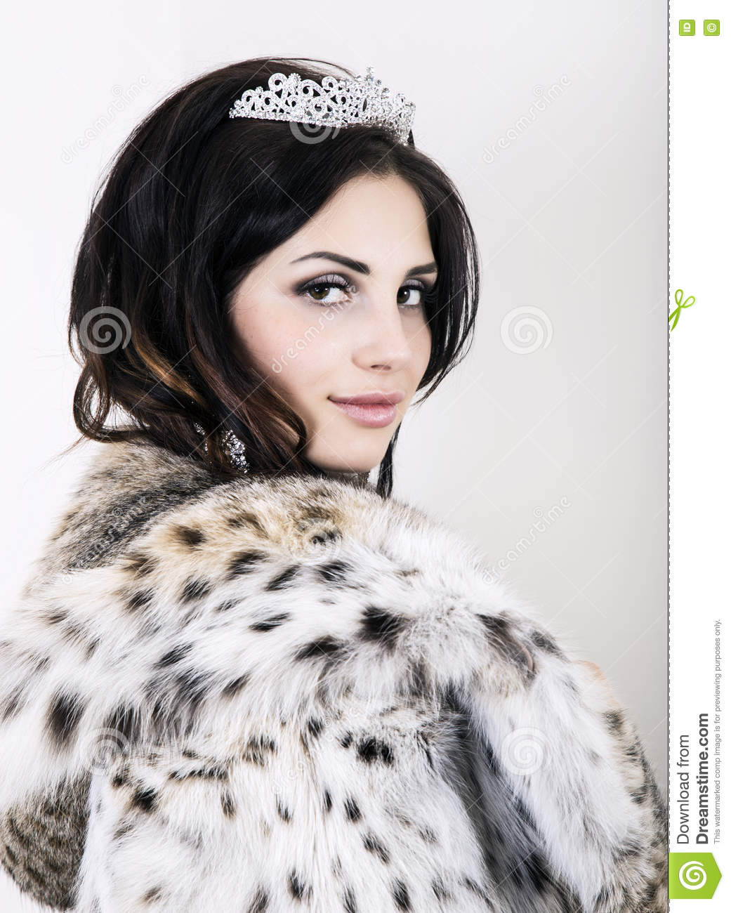 Beautiful Young Bride Wearing White Wedding Dress And Fur