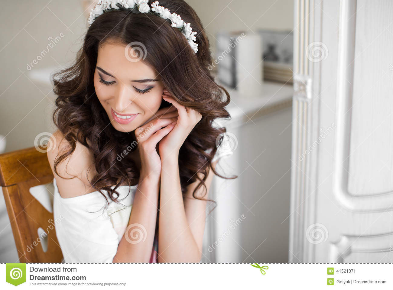 Beautiful young bride wedding makeup and hairstyle