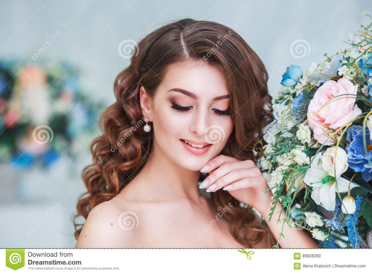 Beautiful Young Bride With Wedding Makeup And Hairstyle