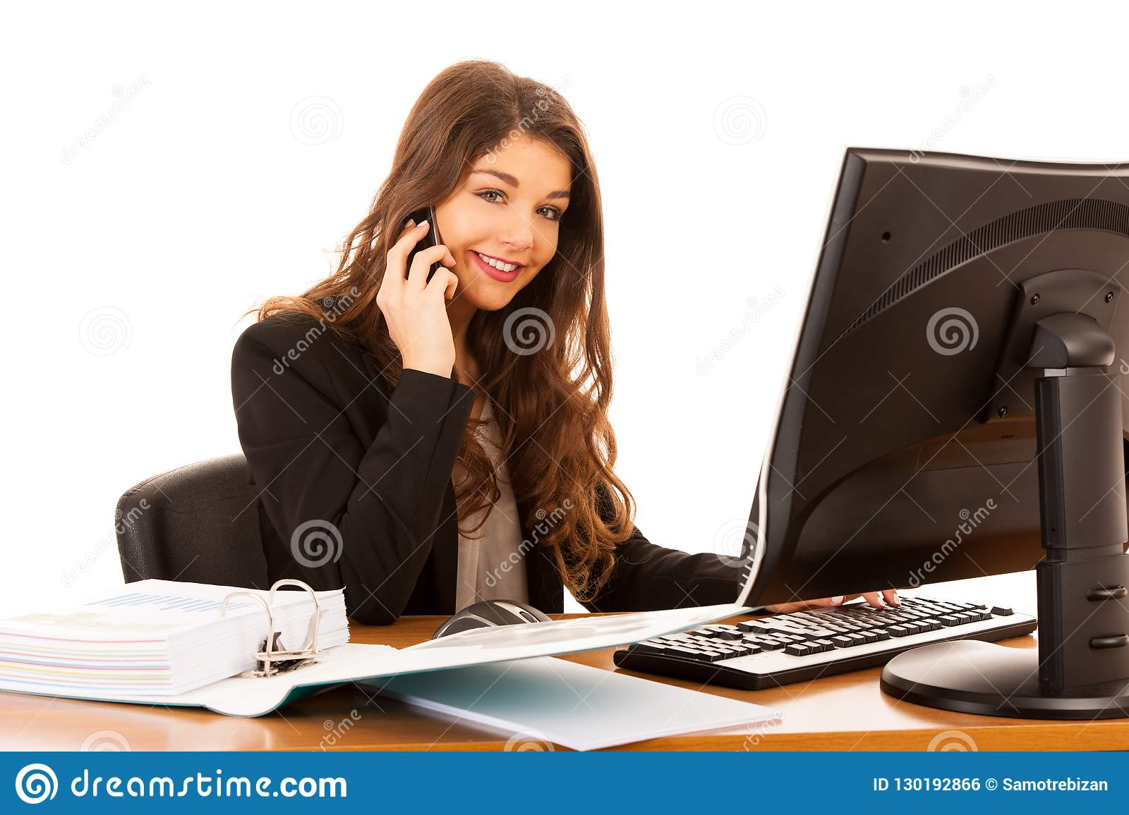 Beautiful young brunette business woman talks on smart phone over white background