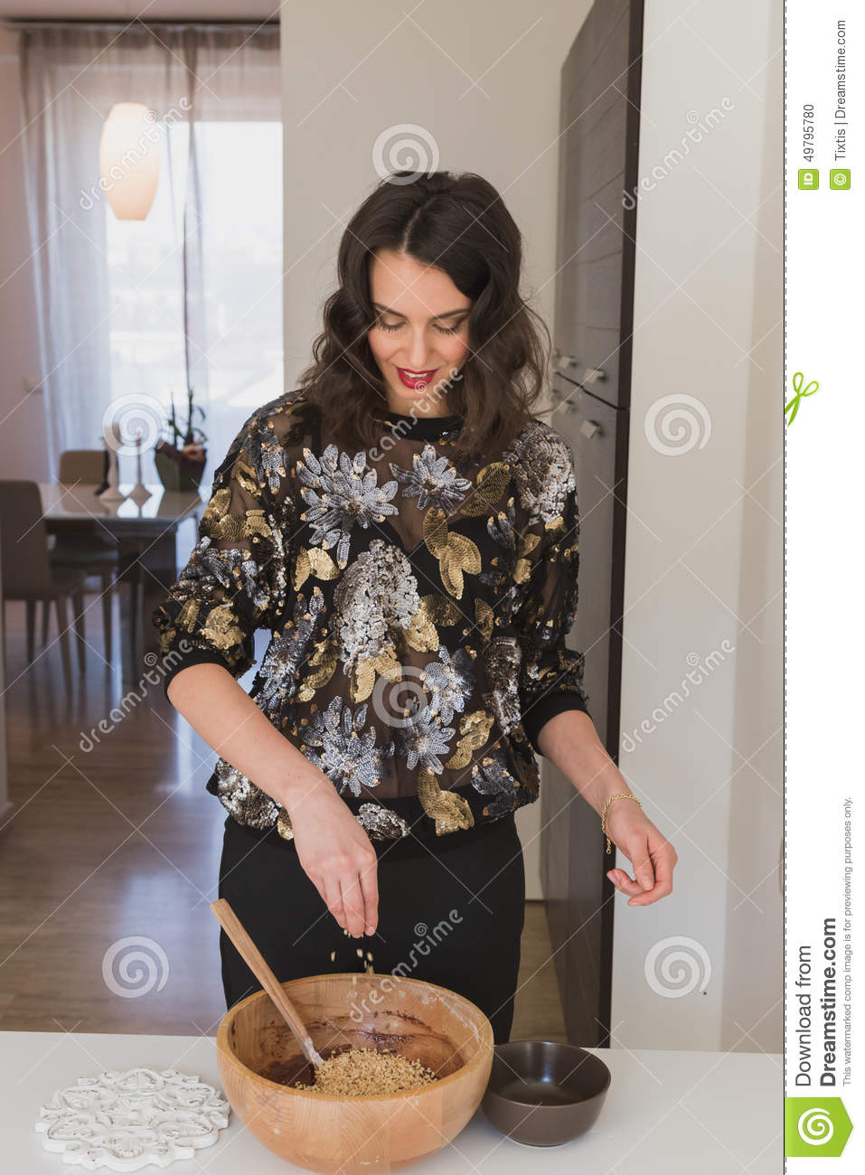 Beautiful young brunette cooking in the kitchen stock for Xnxx in the kitchen