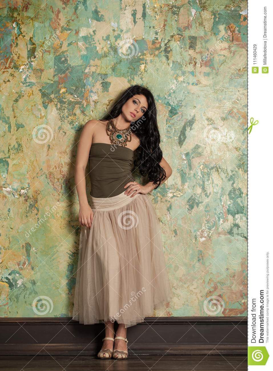 892a0cd28d2 Beautiful Young Brunette Woman in Nice Clothes and High Heels Sandals.  Fashion Photo