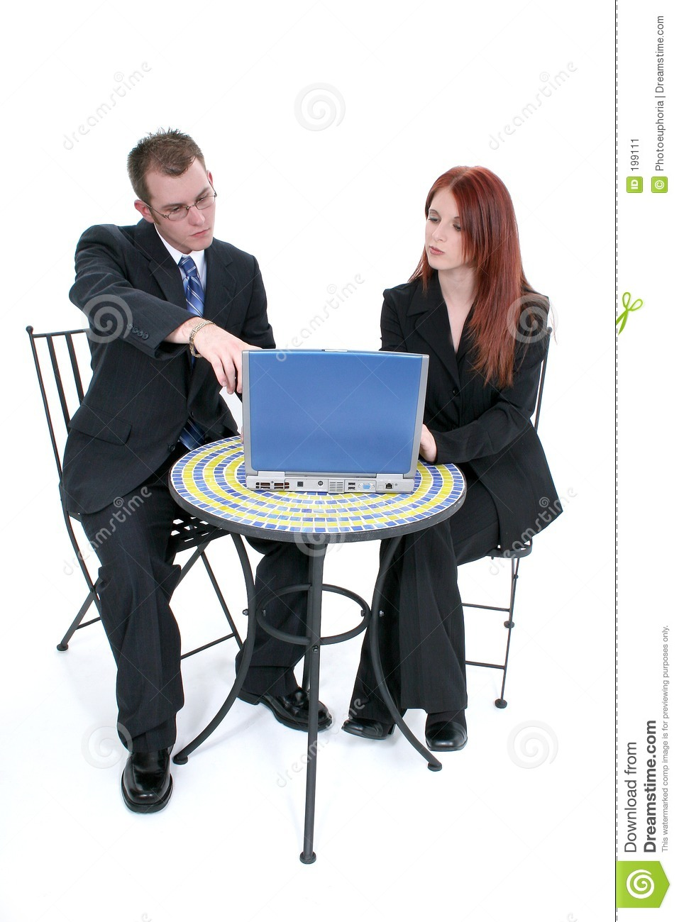 Beautiful Young Business Woman And Man At Table With Laptop