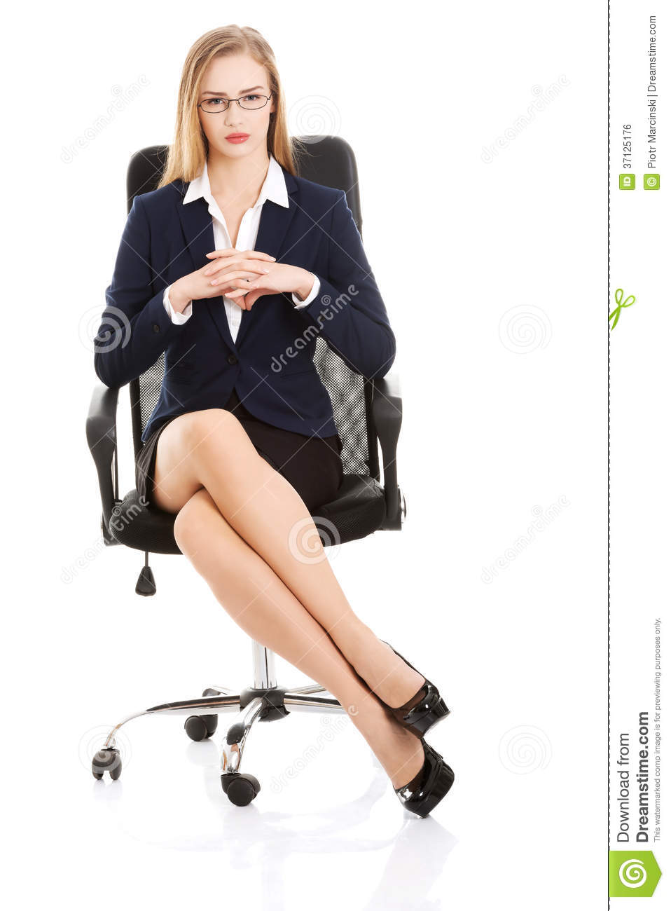 beautiful young business woman sitting on a chair  royalty free stock image