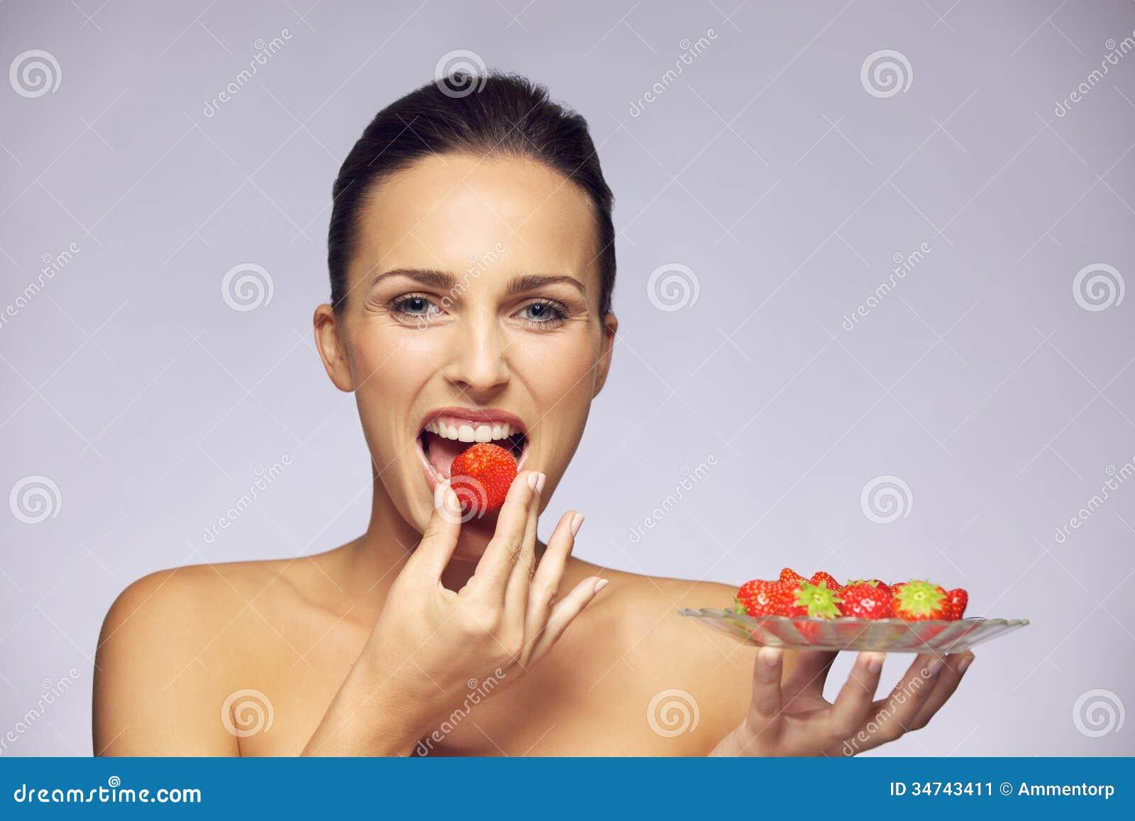 Beautiful Young Caucasian Woman Eating Healthy Fruits Stock