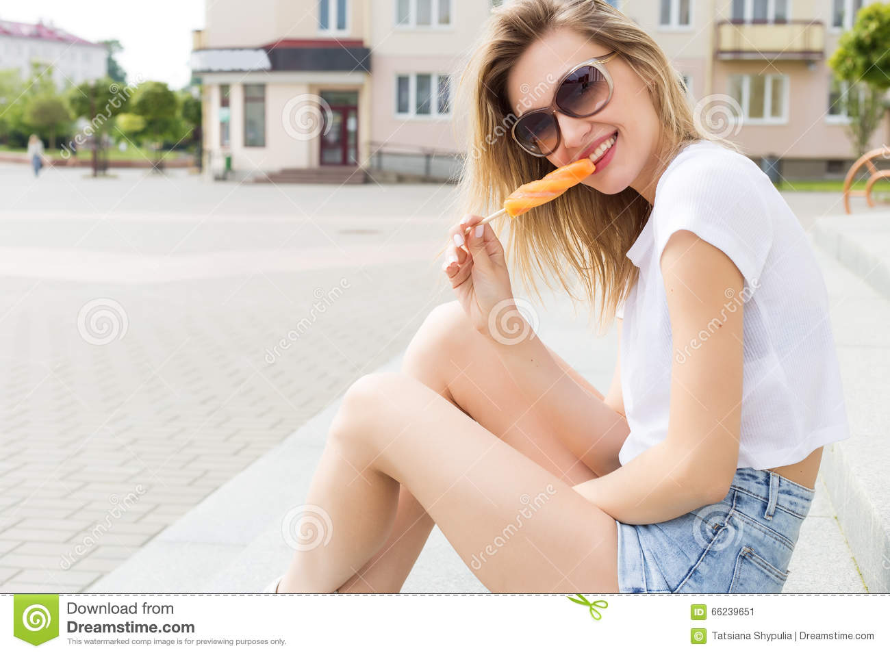 Beautiful Young Cheerful Happy Girl Eating Ice Cream