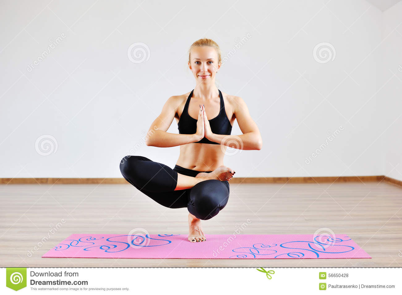 Beautiful Young Couple Doing Yoga On One Leg Position Stock Photo