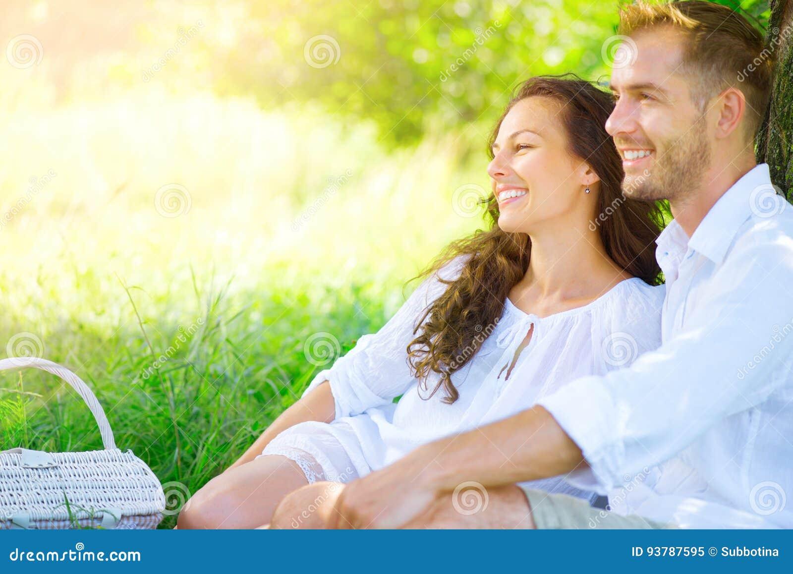 Beautiful young couple having romantic picnic