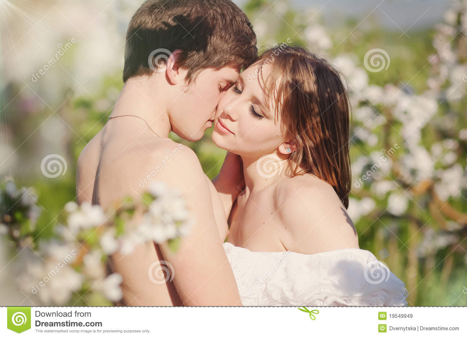 Free Hug Sofa Beautiful Young Couple Kissing In The Flowering Ga Stock